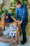 Portrait of family at home. Portrait of happy family looking photobook togerher at home. Family, childhood and leisure concept Royalty Free Stock Photo