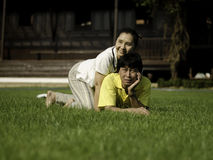 Portrait of a happy family lying on the grass Stock Photos