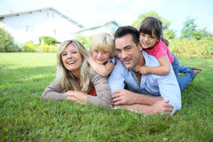 Portrait of happy family lying in grass Stock Photography
