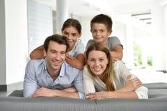 Portrait of happy family lying on sofa feeling relaxed stock photos