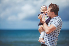 Portrait of a Happy family of man and child having fun by the blue sea in summertime Stock Images