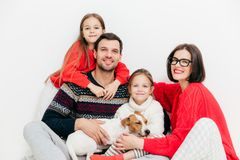 Portrait of happy family members with positive expressions, cuddle and support each other, have good relationship. Delighted stock photography
