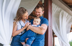 Portrait of a happy family. Mom, dad and baby son.  Stock Photos