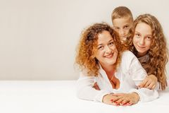 Portrait of happy family. Mother and children: daughter and son. stock images