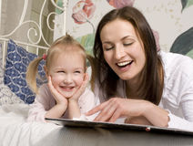 Portrait of happy family, mother and daughter in bed Stock Photo