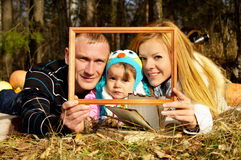 Portrait of happy family on nature autumn Royalty Free Stock Photography