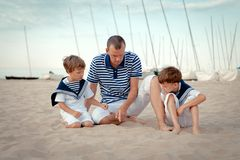 Portrait of happy family near yacht Stock Photos