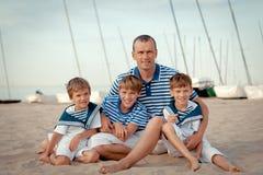Portrait of happy family near yacht Stock Image