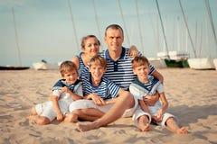 Portrait of happy family near yacht Stock Photo