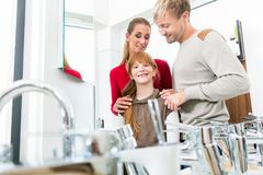 Portrait of a happy family together in the interior of a modern shop stock photography