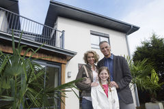 Portrait Of Happy Family Outside New Home Royalty Free Stock Image