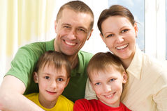 Portrait of a happy family playing on a light Royalty Free Stock Image