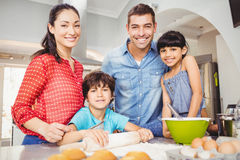 Portrait of happy family preparing food. At home Royalty Free Stock Image