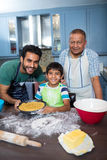 Portrait of happy family preparing food. In kitchen at home Royalty Free Stock Photo