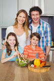 Portrait of happy family preparing vegetable salad. In kitchen at home Royalty Free Stock Image
