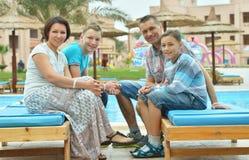 Happy family at resort Stock Photography