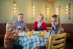 Portrait of happy family in restaurant. Portrait of happy family dining in restaurant stock photo