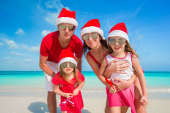Portrait of happy family in Santa hats on the Royalty Free Stock Photos