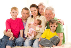 Portrait of a happy family of seven. People on a light royalty free stock photography