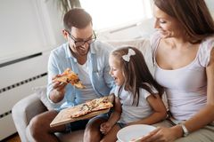 Portrait of happy family sharing pizza at home. Portrait of happy family sharing pizza together at home stock photos