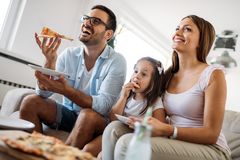 Portrait of happy family sharing pizza at home stock photos