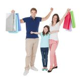 Portrait of happy family with shopping bags Royalty Free Stock Images