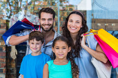 Portrait of a happy family with shopping bags. At the mall stock photography