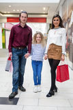 Portrait of happy family with shopping bags Royalty Free Stock Image