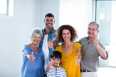 Portrait of happy family showing their thumbs up Stock Photography