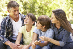 Portrait Of Happy Family Sitting In Garden Together Royalty Free Stock Images