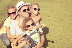Portrait a happy family sitting on the grass Royalty Free Stock Images