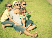 Portrait a happy family sitting on the grass Stock Images