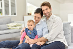 Portrait of happy family sitting at home on sofa Royalty Free Stock Photography