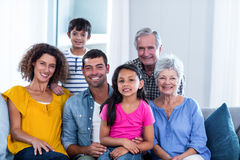 Portrait of happy family sitting together on sofa stock photos
