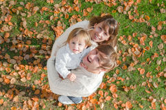 Portrait of a happy family smiling in autumn. A top view Royalty Free Stock Photo