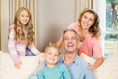 Portrait of happy family on the sofa Stock Photography