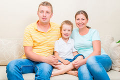 Portrait of a happy family on the sofa Royalty Free Stock Photography