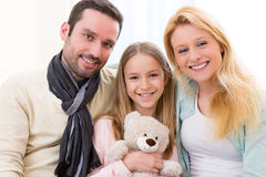 Portrait of a happy family in a sofa Stock Photos