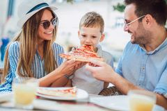 Portrait of happy family spending time together. Portrait of happy family spending time in pizzeria stock images