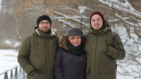 Portrait of a happy family standing on the winter alley and smiles stock video footage
