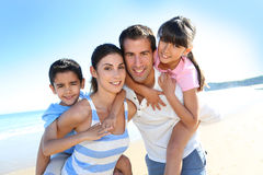Portrait of happy family on summer holidays Stock Photos