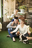 Portrait of happy family with their pet at home Royalty Free Stock Photography
