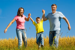 Portrait of a happy family of three. On the nature Stock Images