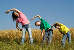 Portrait of a happy family of three. On the nature Royalty Free Stock Photo