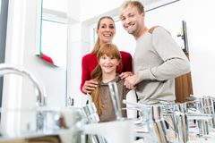 Portrait of a happy family together in the interior of a modern shop royalty free stock photo