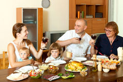Portrait of happy family together over dining table Royalty Free Stock Images