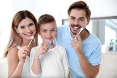 Portrait of happy family with toothbrushes in bathroom. stock photos