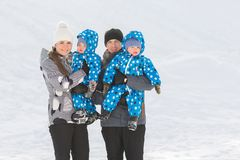 Portrait of happy family with twins in winter Park on a Sunny day Royalty Free Stock Photography