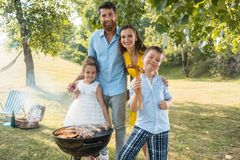 Portrait of happy family with two children standing outdoors royalty free stock image