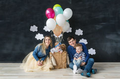 Portrait of happy family with with two small children and pet dog Royalty Free Stock Images